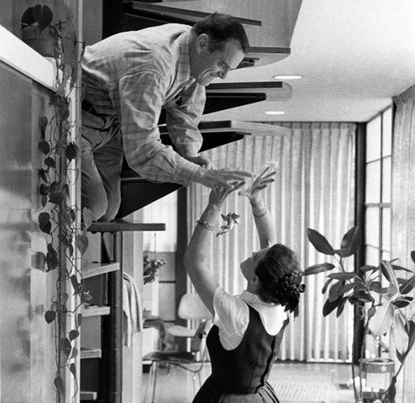 A playful moment for the Eames at home, c. 1970. Image courtesy of KPBS TV.