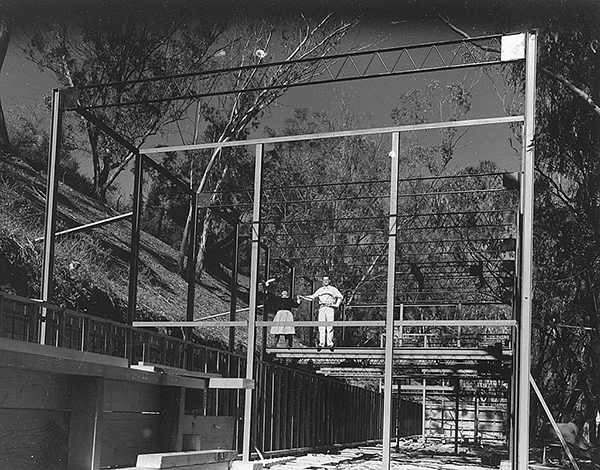 The Eames pose for a photograph as their house goes up in 1949. Image courtesy of the Library of Congress.