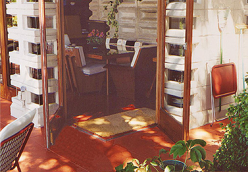 Redwood frame French doors open onto the terrace. Image courtesy of Douglas Steiner.