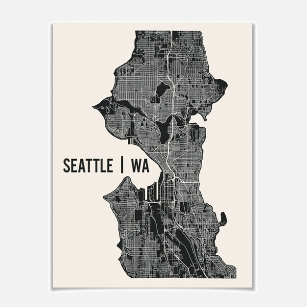 Map of Seattle, available for purchase at Fab. I-5 is the widest white line pictured, and it divides the eastern and western halves of the city.