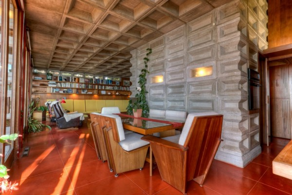 The Tracy House dining room, with Cherokee-red concrete floor tiles. Image courtesy of Redfin.