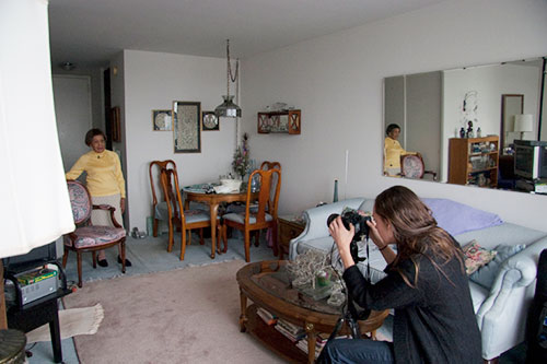 A Detroit woman photographed in her home, among her things for Thanks for the View, Mr. Mies. Image courtesy of Placement Publication.