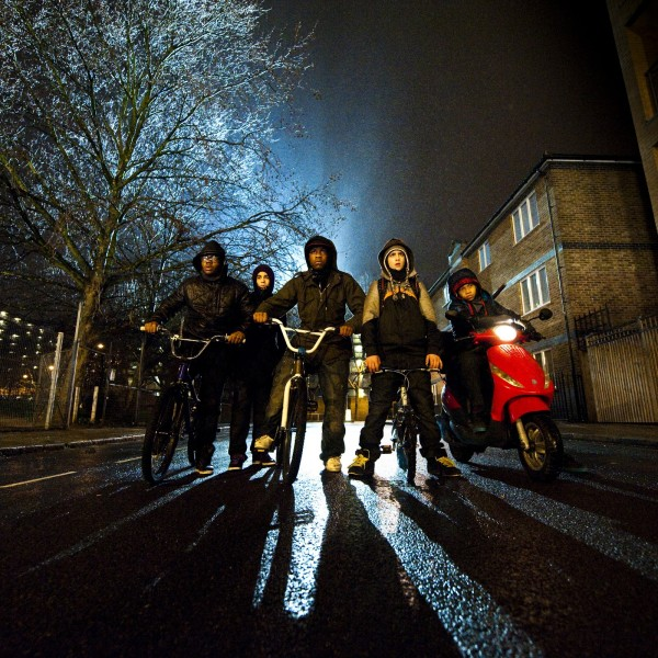 A group of teenage boys prepares to rob a woman in the film's opening scene. Image courtesy of Attack the Block.