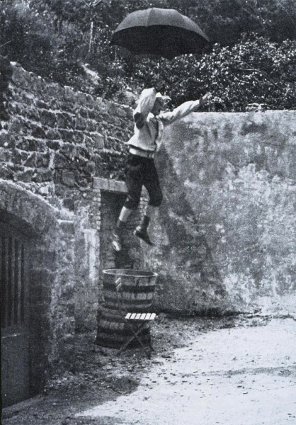Zissou Jumping from a Wall with an Umbrella, early 1900s, by Jacques Henri Lartigue. Image courtesy of Artstor.